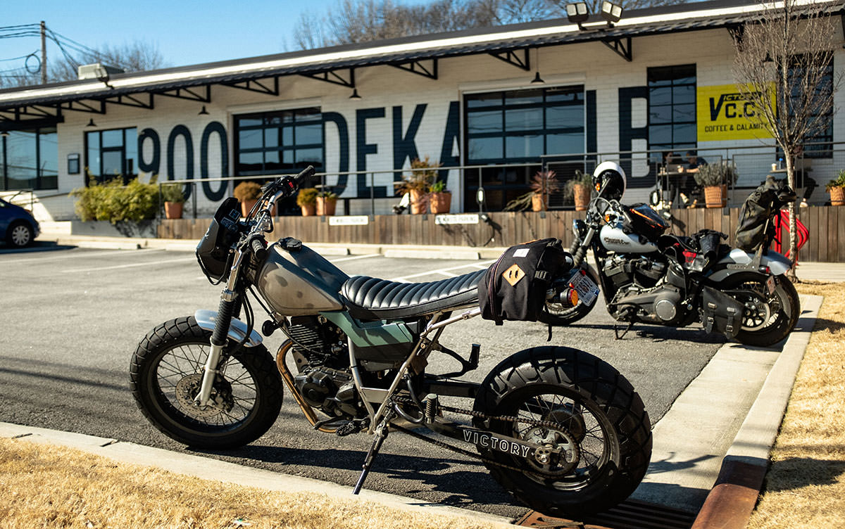 V.C.C. - Victory Coffee Calamity with 2 motorcycles parked outside